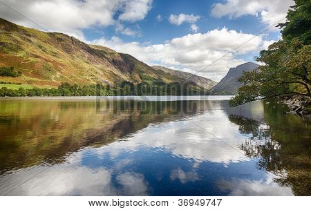 Reflections In Buttermere In Lake District