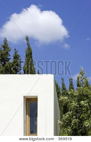 New, White Building With Trees And Blue Sky