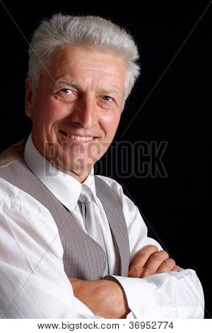 Glad old man in suit