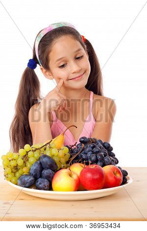Girl with plate of fruit