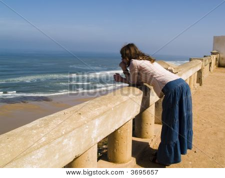 Women Looking At The Ocean