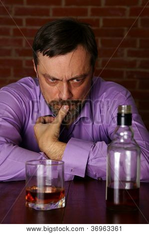 man with whiskey at table