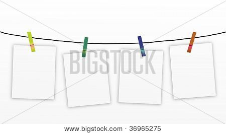 Four Blank Notes Hanging on A Clothesline.