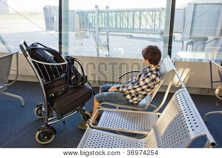 boy waiting in airport