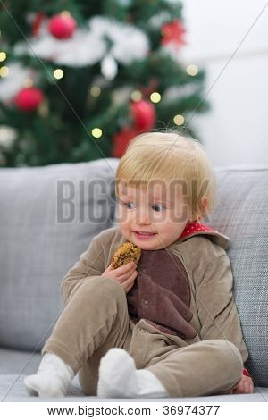 Scared Baby In Christmas Deer Suit With Cookie