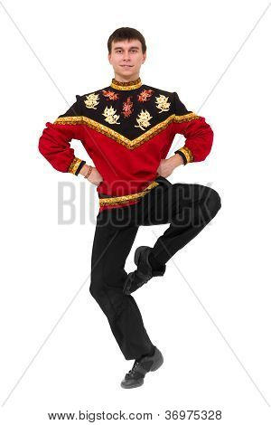 Attractive Man Wearing A Folk Russian Costume Dancing
