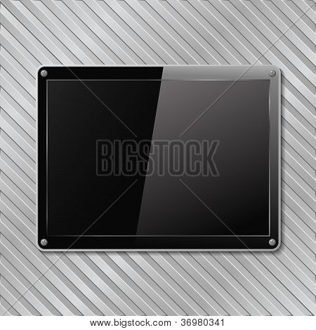 Black plate on metal striped background