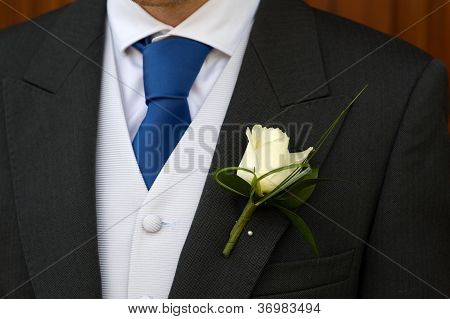 Groom Wearing A White Rose Buttonhole