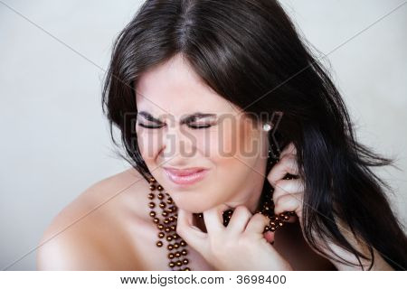 Angry Woman With Beads