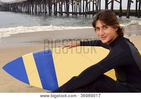 Male Teenage Surfer