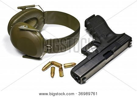 Pistol, Ear Protection And Ammunition Isolated On White Background.