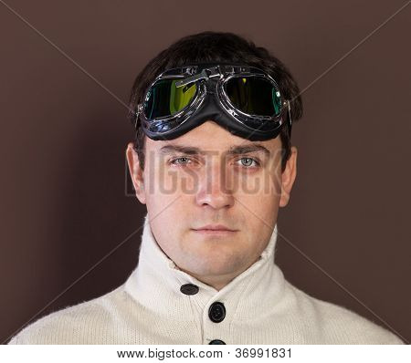 Young Man Wearing Old-fashioned Pilot Glasses