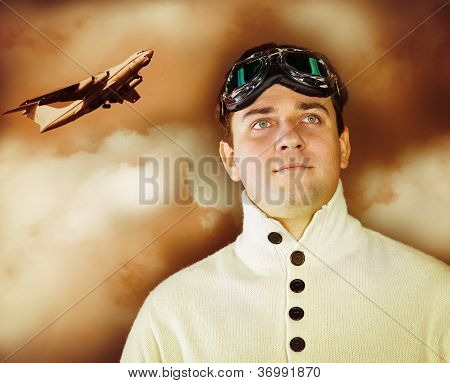 Young Man In Retro Style Clothes Wearing Old-fashioned Pilot Glasses