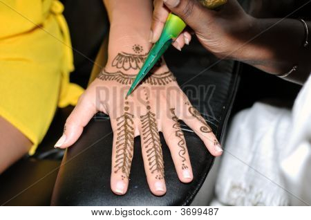 Indian Woman Appliying Traditional Henna Tattoo