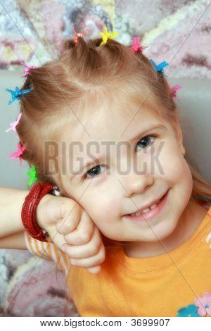 Girl Listens Ticking Of Watch
