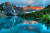 stock photo of sunrise  - Taken at the peak of color during the morning sunrise at Moraine lake in Banff National park - JPG