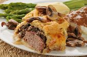 stock photo of beef wellington  - Gourmet Beef Wellington closeup with asparagus and mushrooms  - JPG