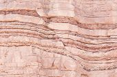 stock photo of sedimentation  - Detail of geological formations in faulted sandstone sedimentary rock - JPG