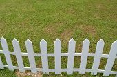 stock photo of white vinyl fence  - a lawn with a white wooden fence - JPG