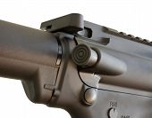 stock photo of ar-15  - Forward assist button toward the back of an ARs receiver