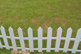 image of white vinyl fence  - a lawn with a white wooden fence - JPG