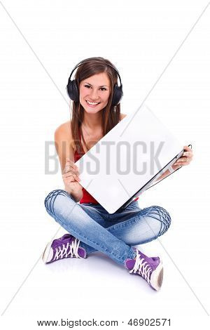 Girl In Headphone Holding Laptop