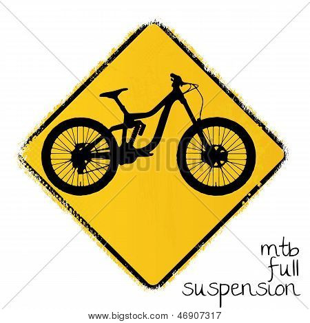 warning road sign with a full suspension mountainbike