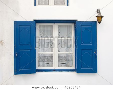Old Window With Blue Shutters And White Curtain. Background.