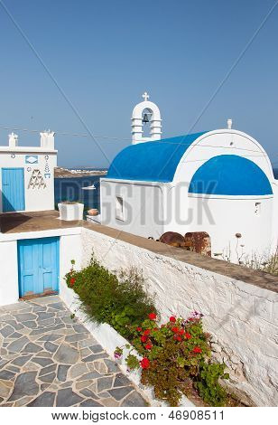 Classical Greek Church With Blue Dome On The Background Of The Sea On The Island...