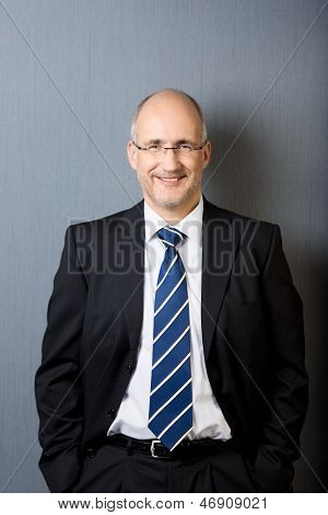 Portrait Of A Relaxed Smiling Mature Businessman