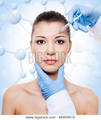 Injection Of Botox In Beautiful Woman Face