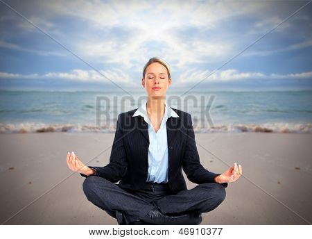 Business woman doing yoga on the beach. Vacation.