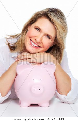 Senior woman with a piggy bank. Isolated on white.