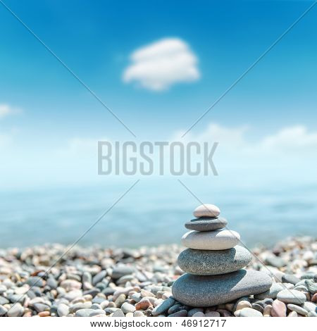 heap of stones like zen near sea. soft focus