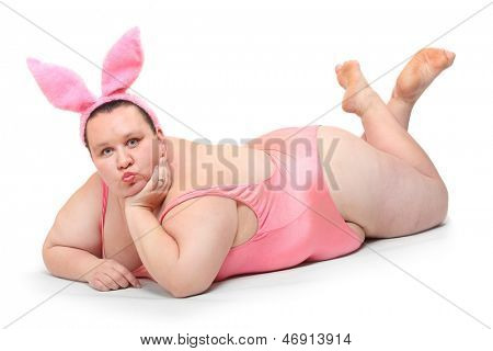 Funny picture of a plus size woman in a pink swimsuit and rabbit ears.