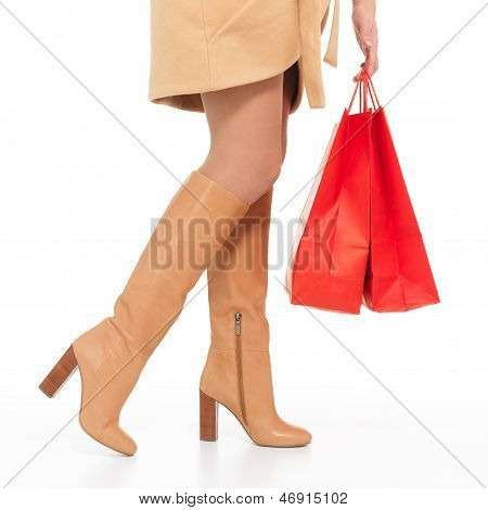 Woman In Autumn  Boots With Shopping Bags