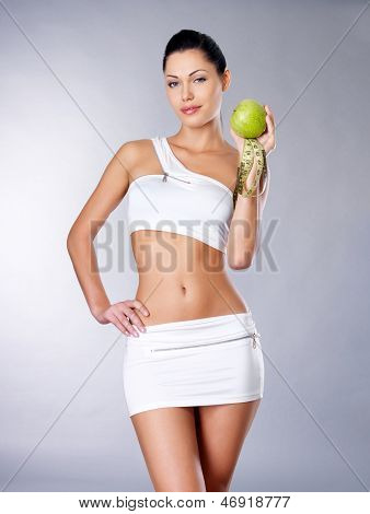 Healthy Girl With A Measuring Tape And Apple