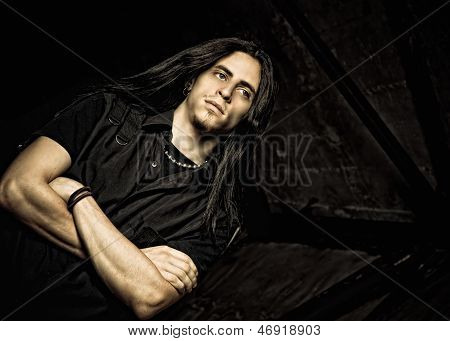 Portrait Of Handsome Young Man With Long Hair. Low Key
