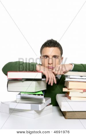 Young Unhappy Student With Stacked Books
