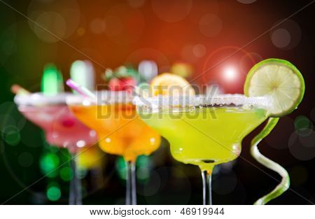 Fruit cocktails on black background