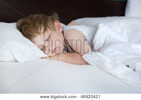 Little Sweet Toddler Boy Sleeping In His Bed