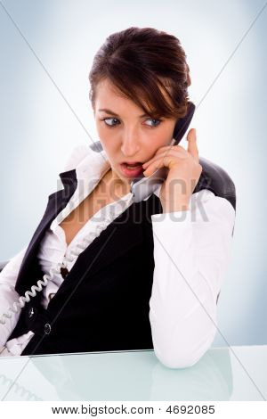 Front View Of Angry Female Corporate Woman Talking On Phone