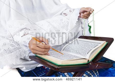 Close-up Female Muslim Reading Quran On White