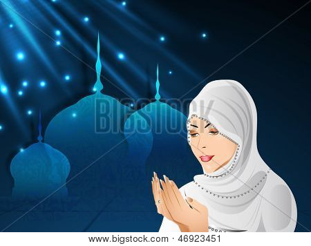 Young Muslim girl in traditional dress(hijab) praying(reading Namaz, Islamic Prayer) on shiny blue background with mosque.