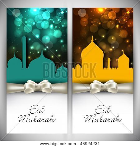 Muslim community festival Eid Mubarak greeting card or gift card with shiny mosques and white ribbon.
