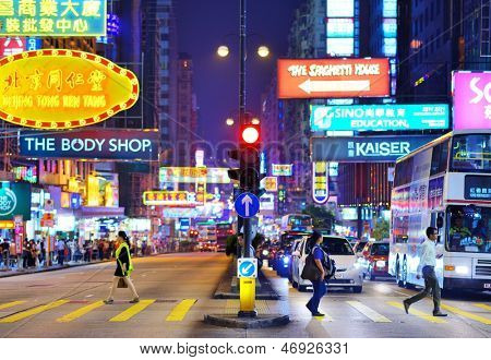 HONG KONG - OCTOBER 8: Traffic and pedestrians on Nathan Rd October 8, 2012 in Hong Kong, China. The street is a main thoroughfare through Kowloon and is line with shops and restaurants.
