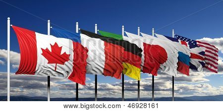 Flags of G8 members against blue sky