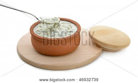 Azerbaijani Cuisine - Dovga, yogurt and herb soup isolated on white background