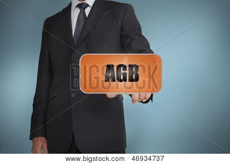Businessman selecting orange tag with agb written on it on blue background