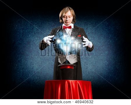 magician causes the magic out of the hat